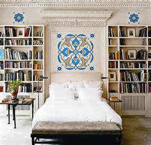 bookshelves around bed built in bookcase eclectic bedroom