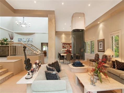 Decorating Open Concept Homes split level living room using beige colours with carpet