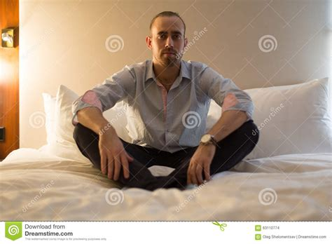 the bed guy man on the bed stock photo image 63110774