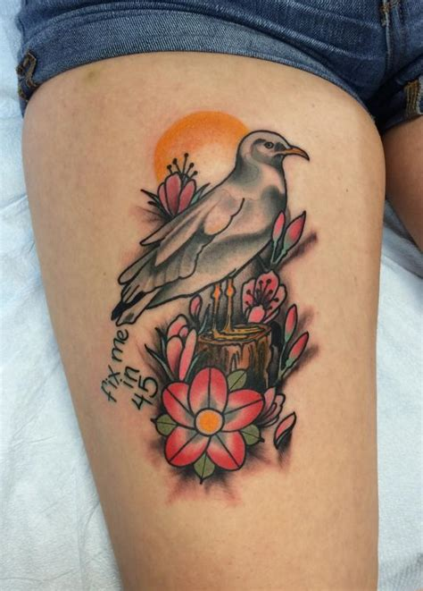 traditional color seagull with flowers tattoo mike riedl