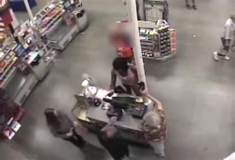 Stealing Gift Cards - surveillance video shows crooks dressed in drag push clerk steal gift cards