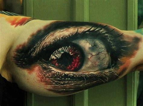 tattoo eye red dreadful red eye tattoo on arm tattooimages biz