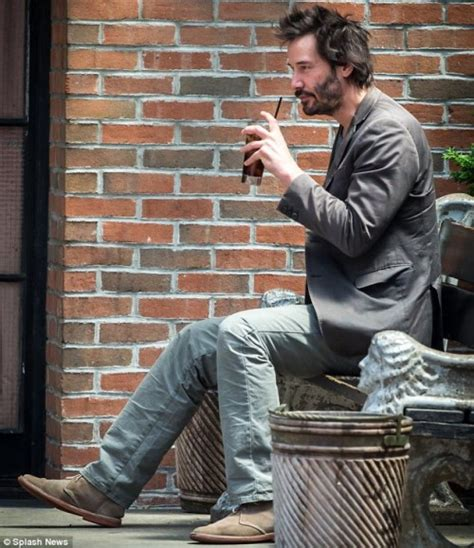 keanu reeves on a bench hark it s the return of sad keanu reeves today s evil