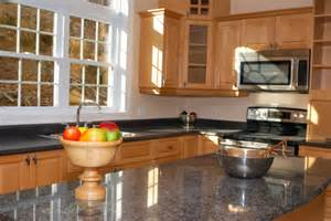 granite countertops with light maple cabinets granite