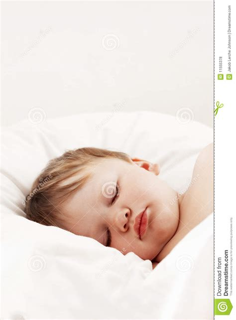 baby sleeping in bed baby sleeping in white bed royalty free stock photos image 11555378