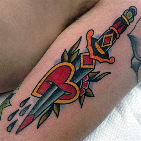 heart and dagger tattoo designs awesome dagger going through traditional arm