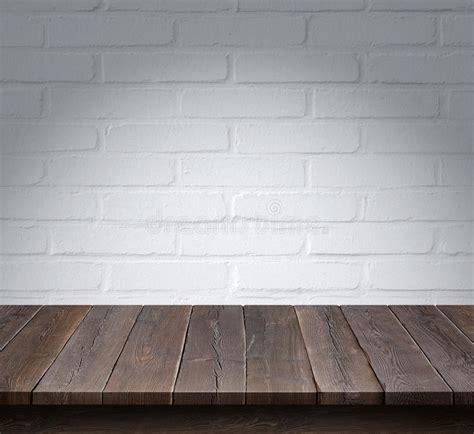 wood table  white brick wall background stock photo