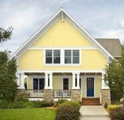 yellow house blue door home exterior