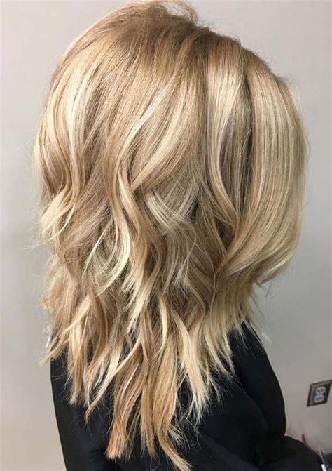 medium length layered hairstyle   women modren villa
