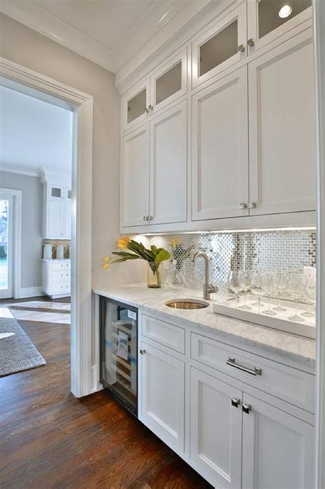 white butler pantry  stainless steel mini brick tile