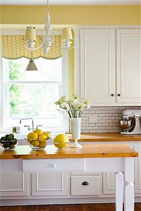 yellow and white kitchen cabinets pinterest