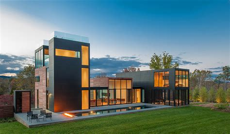 modern contemporary house rigorous geometry contrasting a peaceful landscape