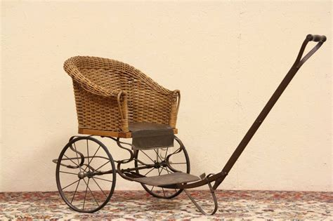 sold wicker child  antique pull chair carriage