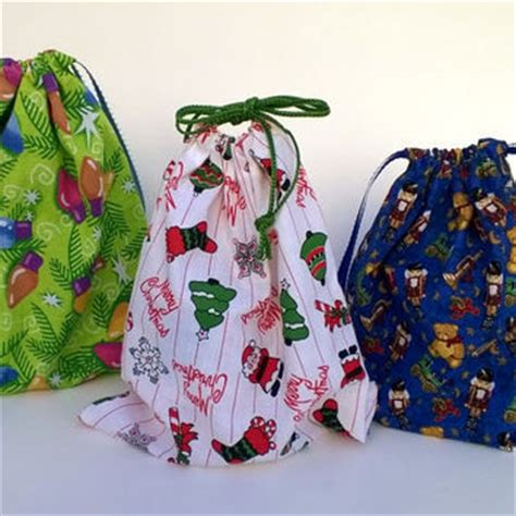 3 christmas drawstring gift bags from debupcycles on etsy