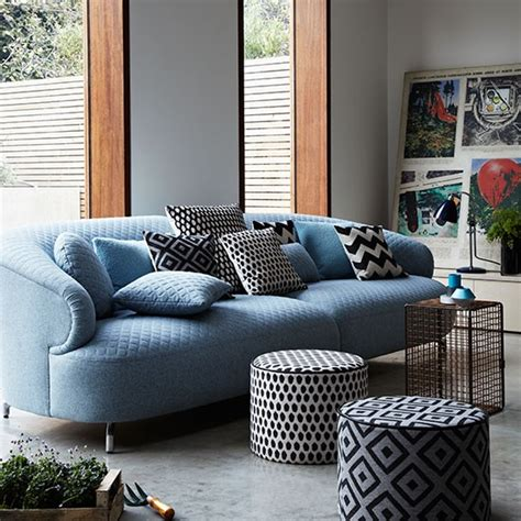 modern living room with blue sofa and poufs decorating