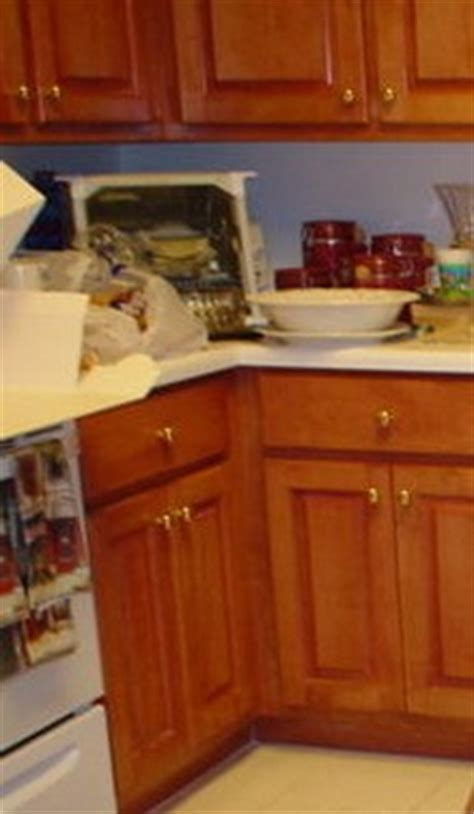 how to get grease wood cabinets cleaning grease from kitchen cabinets thriftyfun