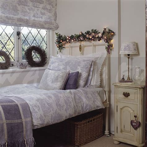 white and mauve bedrooms image lighted garland above white cast iron bed with
