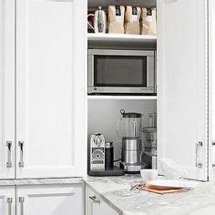 pocket doors in kitchen cabinetry perfect for hiding a tv pocket doors in kitchen cabinetry perfect for hiding a tv