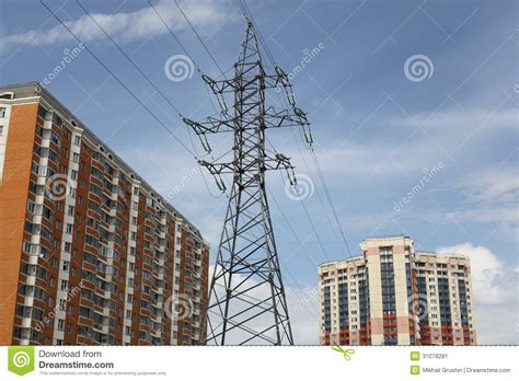 Power line and houses stock image. Image of electricity