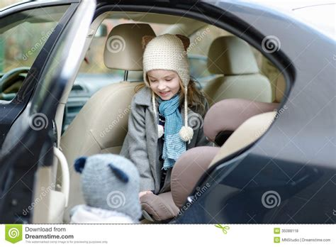 Gets Into Another Car by Getting Into Car Seat Stock Photo Image