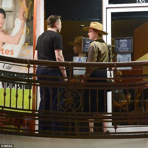 elon musk rolling stone amber heard and elon musk leave sushi dinner holding hands