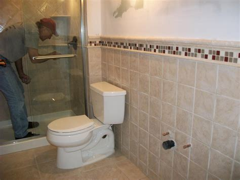 tiling a small bathroom bathroom with shower and toilet design feature royale honed marble wall tile and brown mosaic