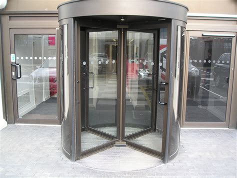 Revolving Glass Door Spinning Door Using Automatic Revolving Glass Door Or Entering Rotating Spinning Glass