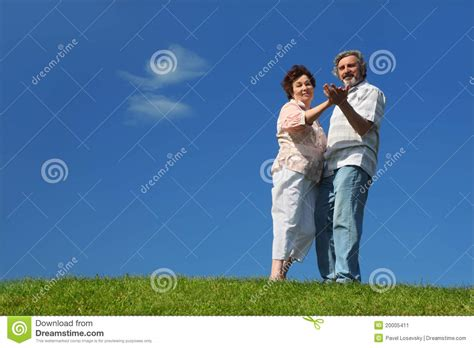 old man dancing to house music old woman and man dancing on lawn stock image image 20005411