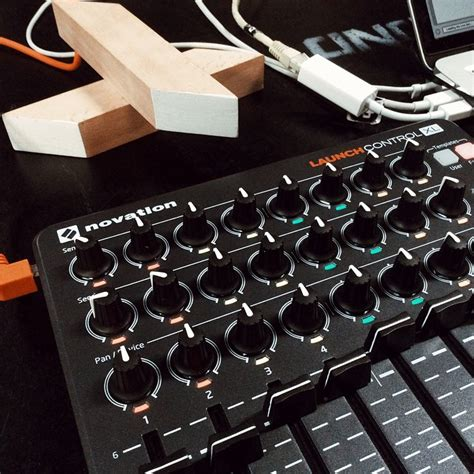 novation s launchcontrol xl has the faders and knobs you