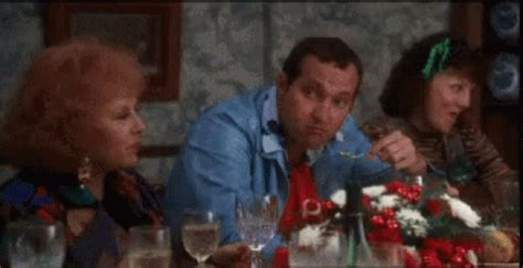 cousin eddie eating gif cousineddie christmasdinner nationallampoon discover share gifs