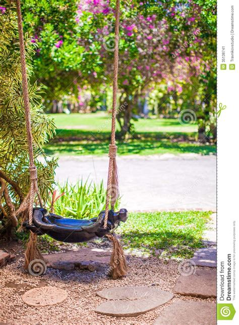 swing in the garden close up of a beautiful swing in the garden stock image