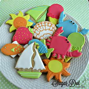 summer decorated cookies here s the table all set up lots of cookies and bagged icing