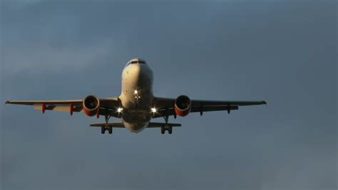 airplane landing lights plane flies airport landing lights to land stock