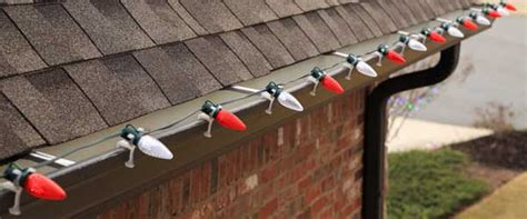 christmas light gutter hangers how to hang lights safely