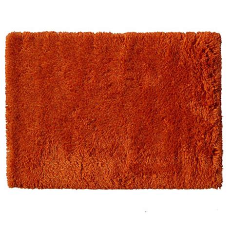 shaggy orange rug buy highlander shaggy rug mixed orange 110x170cm the real rug company