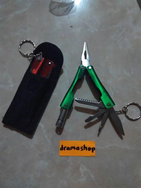 Tang 8 Multifungsi Senter Pisau Obeng Gergaji Pembuka Botol Kaleng jual gantungan kunci multi fungsi tang senter pisau lipat dramashop