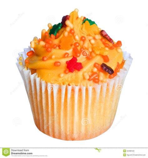 colored frosting cupcake with orange frosting and colored sprinkles