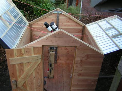 astronomical observatory clampshell roof  flip top design