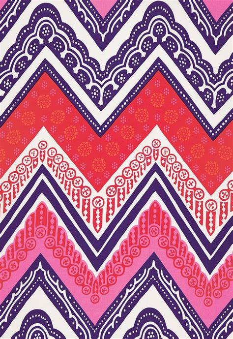 bold colors and arabesque patterns make this red pink purple and white chevron fabric really