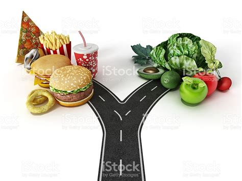 cooking with chagne choice between fast food and healthy food stock photo