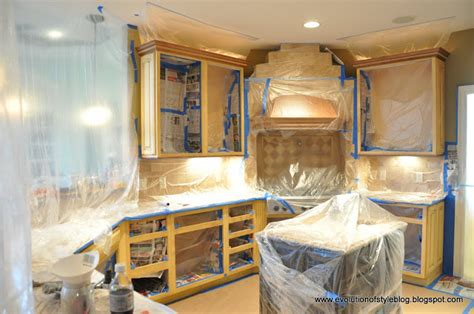spray painting kitchen cabinet to give new to the