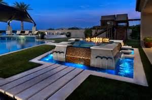 Luxury garden and pool design with modern pool with fire pit and chic