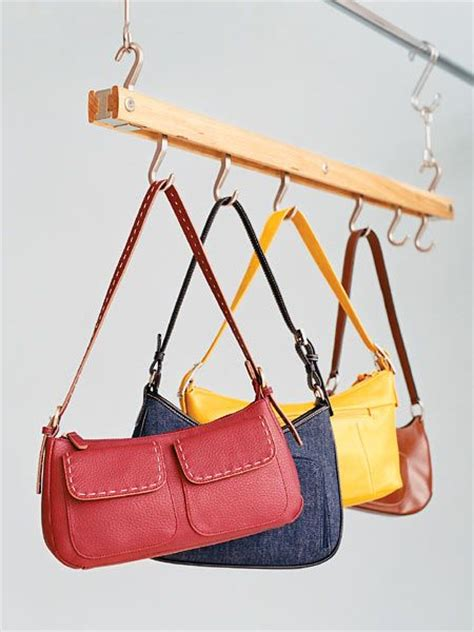 Purse Rack For Closet by Purses Hanging On Rack Organization Purses