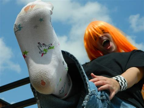holes in the soles of rainbow unicorn socks by