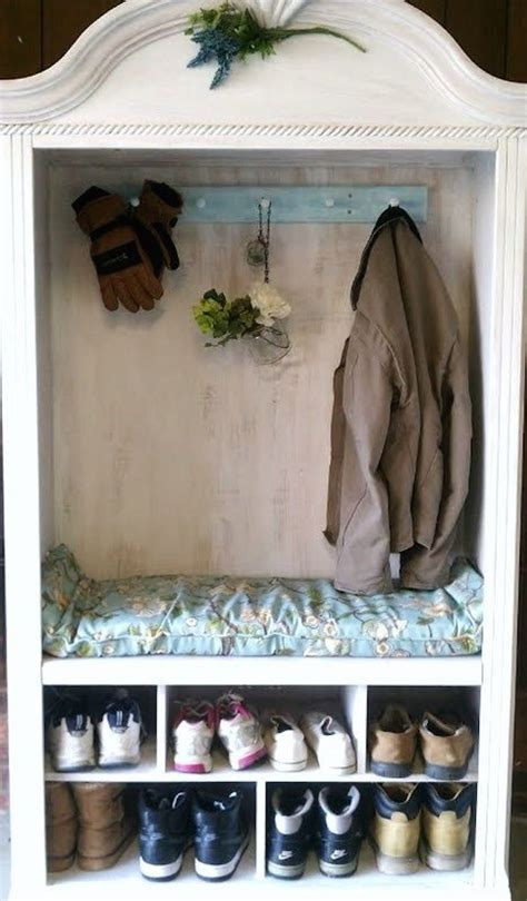 coat armoire armoire used for coat and shoe storage in a mud room
