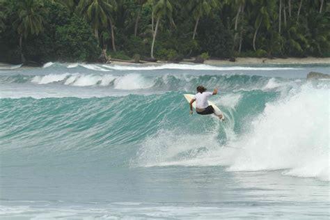 surfing seminyak beach bali indonesia