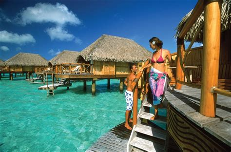 17 best images about overwater bungalows on pinterest a couple on their overwater bungalow www tahiti and