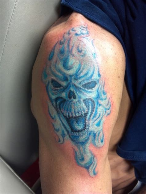 blue flame tattoo blue ink and on shoulder