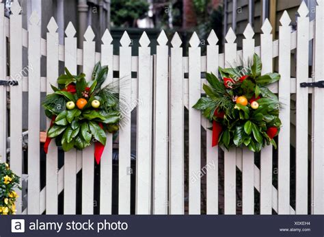 images of christmas garland on a fences decorations of greenery wreaths decorate on white picket fence gate portsmouth