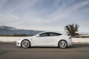 2017 tesla model s p100d side in motion 02 motor trend